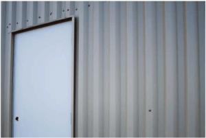 Metal building installed walls